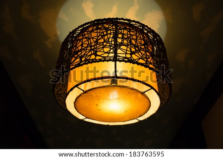 A round shaped vintage lamp on the ceiling - stock photo