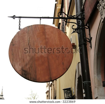 a round wooden sign - stock photo