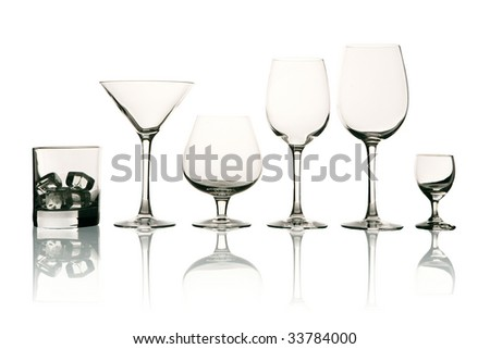 A row af emtpy stemware on white background with reflections (with clipping path)