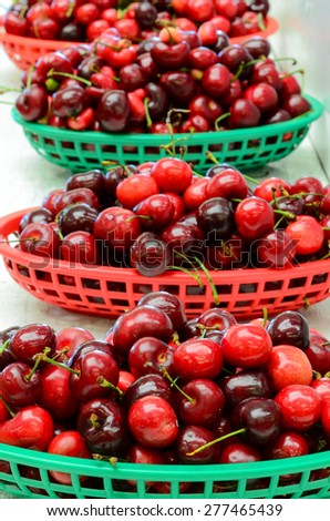A row basket of organically grown bing cherries in a local fruit market at Ellensburg, Washington, US - stock photo