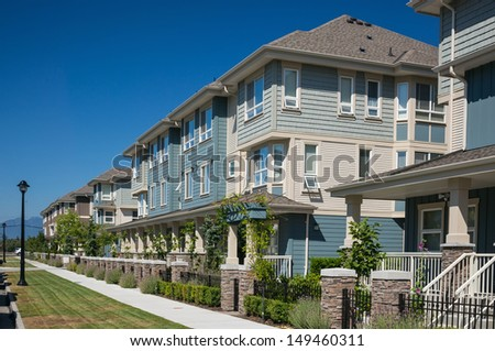 A row of a new townhouses in Richmond, British Columbia - stock photo