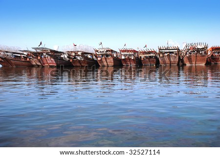 A row of arabic traditional, wooden boats. - stock photo