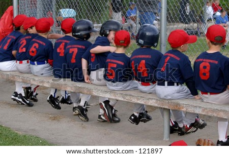 A row of baseball players. - stock photo