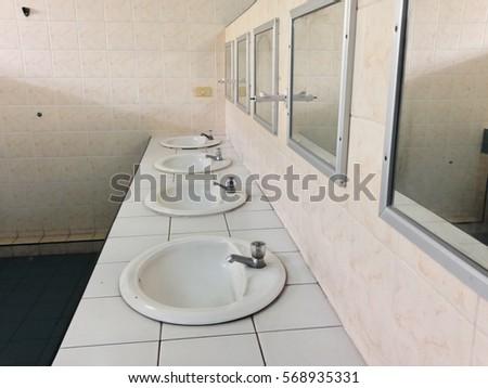 school bathroom. A row of basins in the bathroom with mirrors a public toilet School Bathroom Stock Images  Royalty Free Vectors
