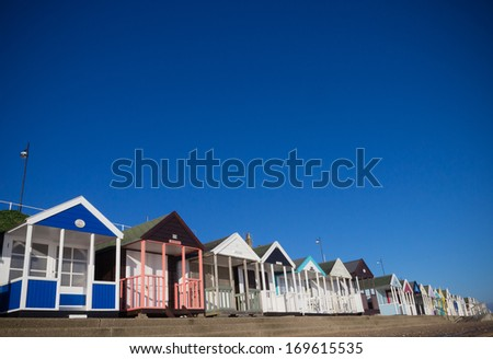 A row of beach huts at Southwold, on a bright Summer day - stock photo