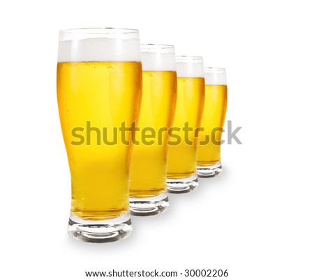 A row of beer pints isolated on white background - stock photo