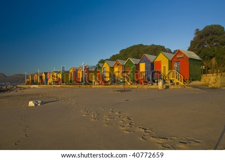 A row of brightly colored beach huts. Taken at St James, South Africa tken at sunrise - stock photo