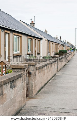 A row of bungalows on a street in Lossiemouth, Scotland - stock photo