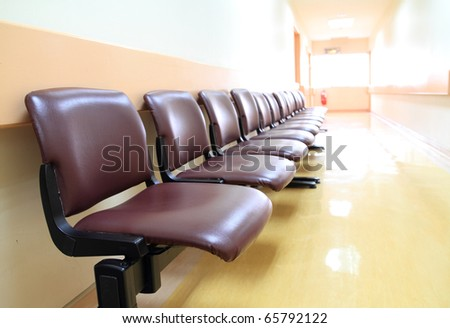 a row of chairs in the hospital hallway. - stock photo