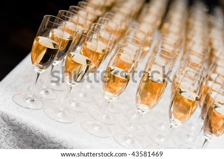 A row of champagne glasses - stock photo