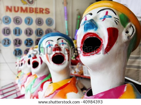 A row of clowns at a carnival.