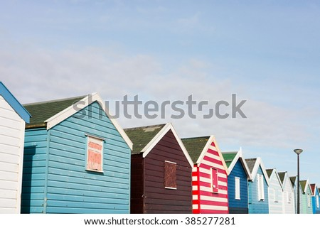 A row of colourful beach huts in Southwold, UK