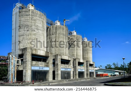 A row of concrete ash silos in power plant