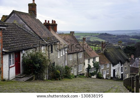A row of cottages on a steep cobbled street at Gold Hill in Shafetsbury, Dorset