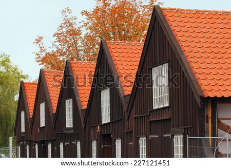 A row of Danish houses covered with red tiling - stock photo