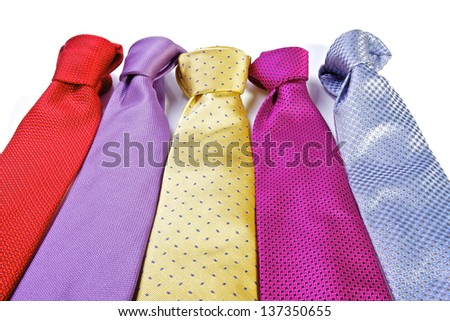 A row of different ties in bright designs - stock photo