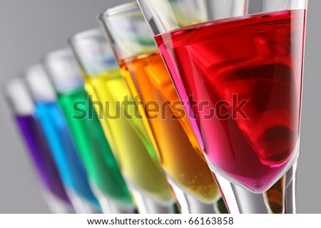 A row of drinks in rainbow colours - stock photo
