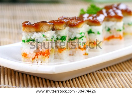 A row of eel and crab seed sushi - stock photo