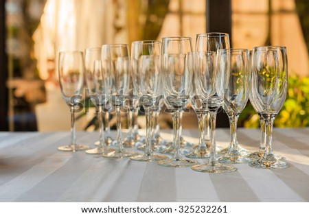 A row of empty champagne glasses - stock photo