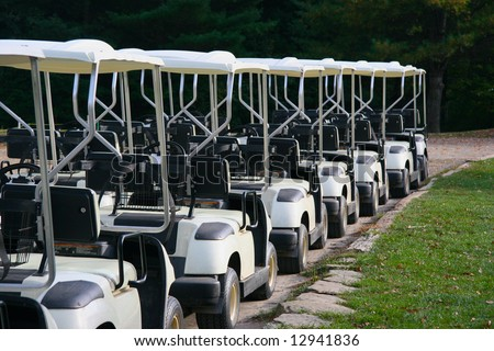 A row of empty golf carts at a country club. - stock photo