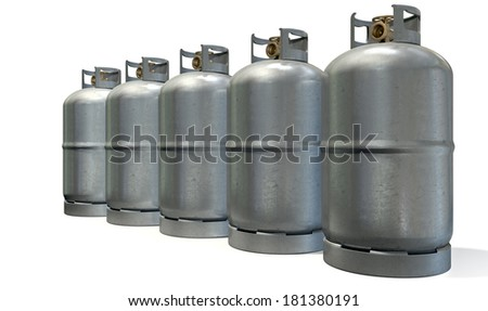 A row of five clean unbranded metal gas cylinders with bronze valves on an isolated white background - stock photo