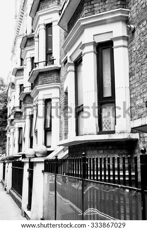 A row of georgian style town houses in London, in black and white - stock photo