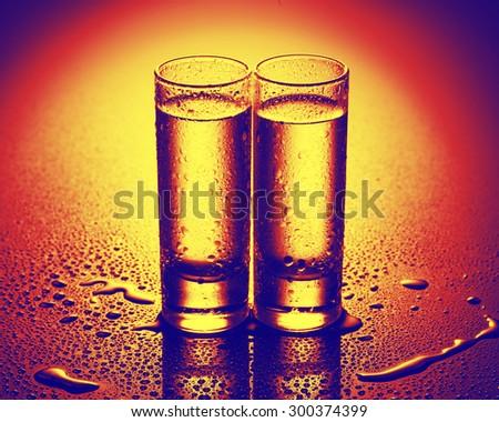 A row of glasses for vodka. studio shot - stock photo