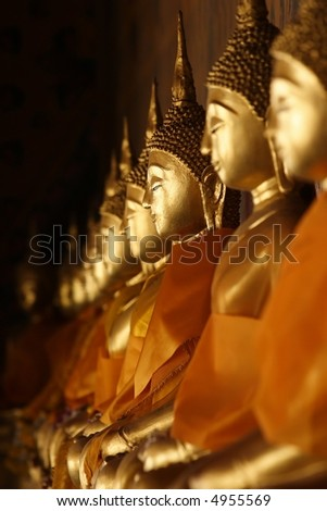 A row of golden buddha statue at Thailand Temple. - stock photo