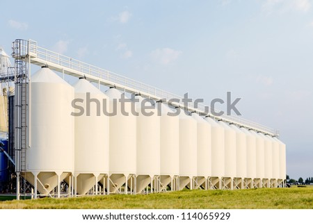 A row of granaries for storing wheat and other cereal grains. - stock photo