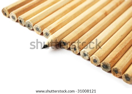 A row of graphite pencils with one in different position as a symbol of difference and opposition - stock photo