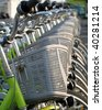 A row of green rental bicycles with baskets - stock photo