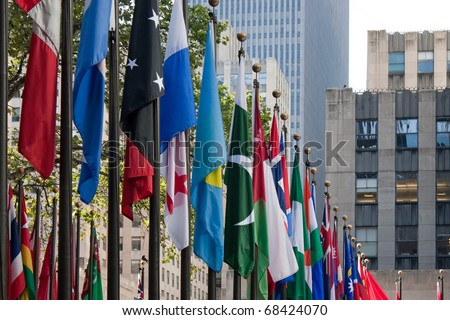 A row of international flags from all over the world in the city of New York. - stock photo