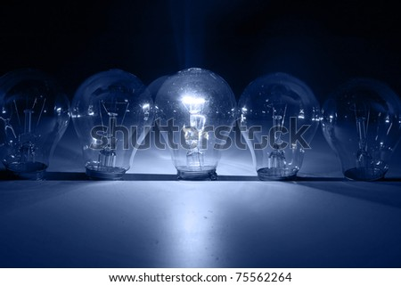 A row of light bulbs - stock photo
