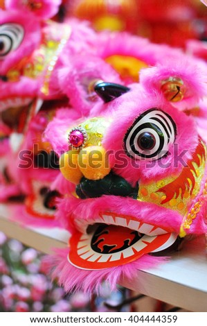 A row of Lion Dance Costume on display - stock photo