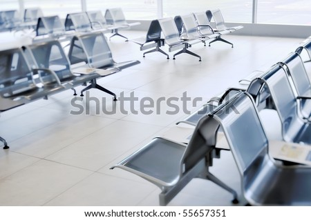 A row of metal chairs in the airport - stock photo