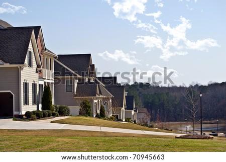 A row of modern houses in a suburban neighborhood. - stock photo