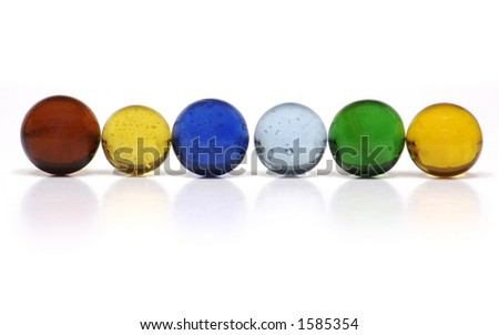 A Row of Multi-Colored Clear Glass Marbles on a White Background.