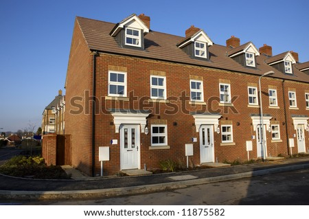 A row of new terraced houses - stock photo