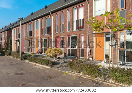 a row of new terraced houses in the Netherlands - stock photo
