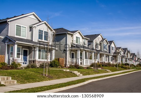 A row of new townhouses or condominiums. - stock photo