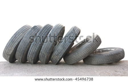 A row of old obsolete tires isolated on white - stock photo
