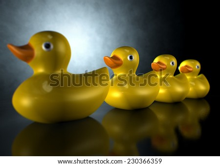 A row of organized and ready yellow rubber bath duck toys on an isolated dark background - stock photo