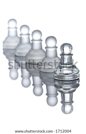 A row of pawns with their reflection - stock photo