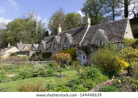 A row of picturesque, historic cottages in the village of Bibury, in the Cotswolds, UK. - stock photo