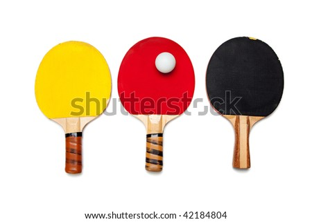 A row of ping pong paddles on a white background - stock photo