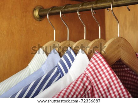 a row of shirts hanging - stock photo