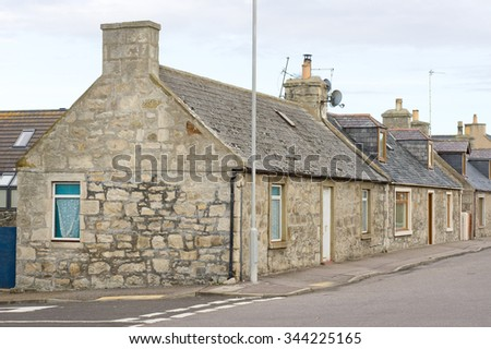 A row of single storey stone cottages in Scotland - stock photo