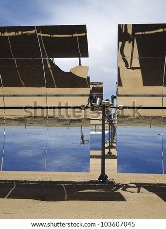 A row of solar mirrors in the Mojave Desert. - stock photo
