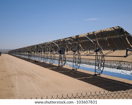 A row of solar mirrors in the Mojave Desert.