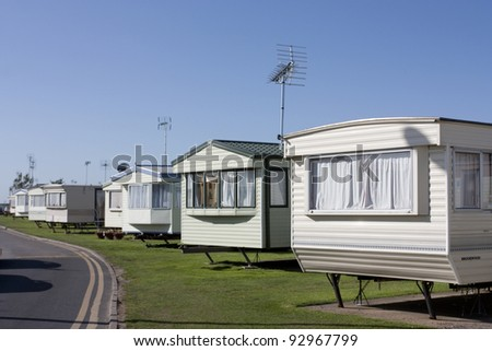 a row of static caravans on a typical british summer holiday park - stock photo
